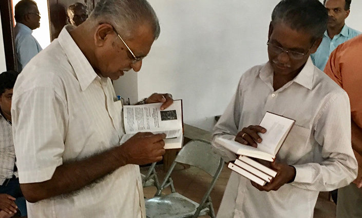 Indian men reading Luther's Small Catechism