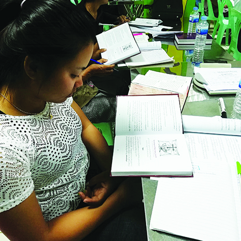 Cambodian girl reading LHF book