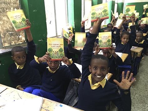 Enthusiastic Lutheran school children proudly display their new Bible storybooks, translated by LHF into the Amharic language.