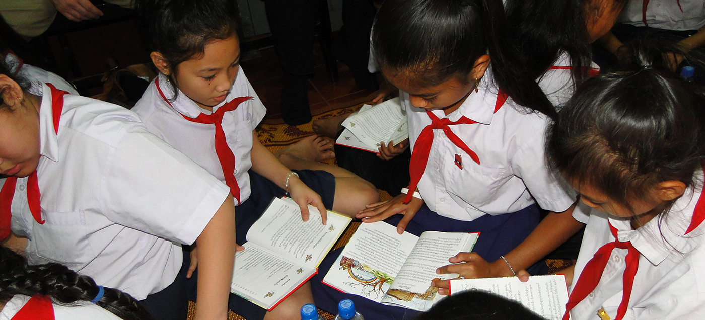 Laos Girls Reading A Child's Garden of Bible Stories