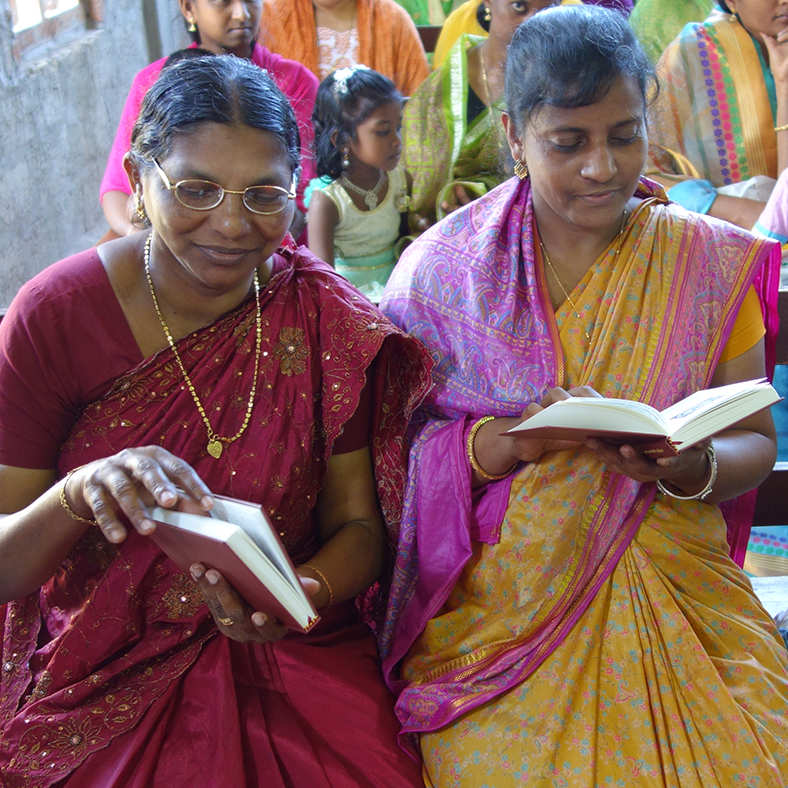 Indian women reading Luther's Small Catechism